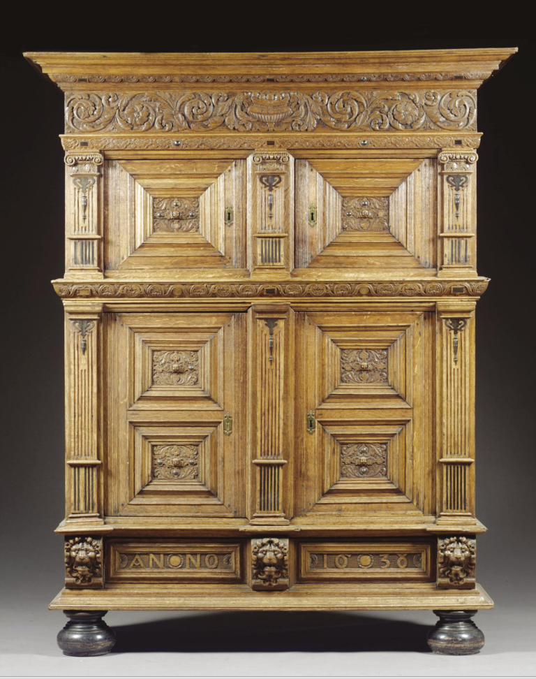 A PRESS CUPBOARD, FLEMISH, DATED 1638  carved oak and ebony inlaid, the the lower cupboard enclosing a shelf  h.210cm., w.164cm. d.55cm.