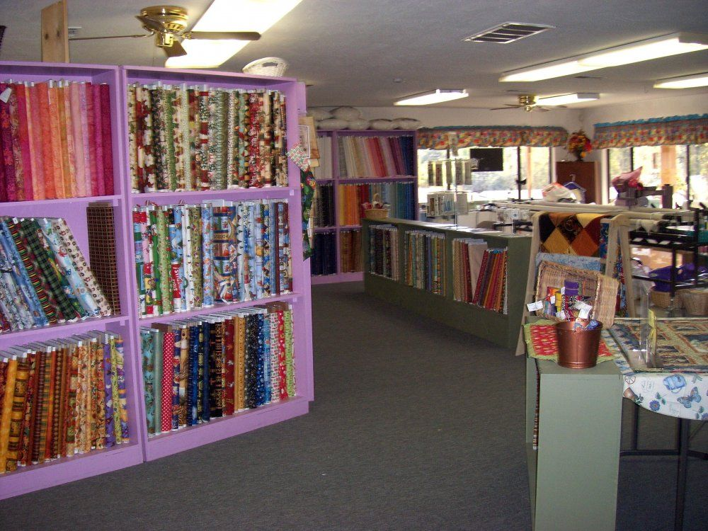 professional long arm in a quilt store - Google Search