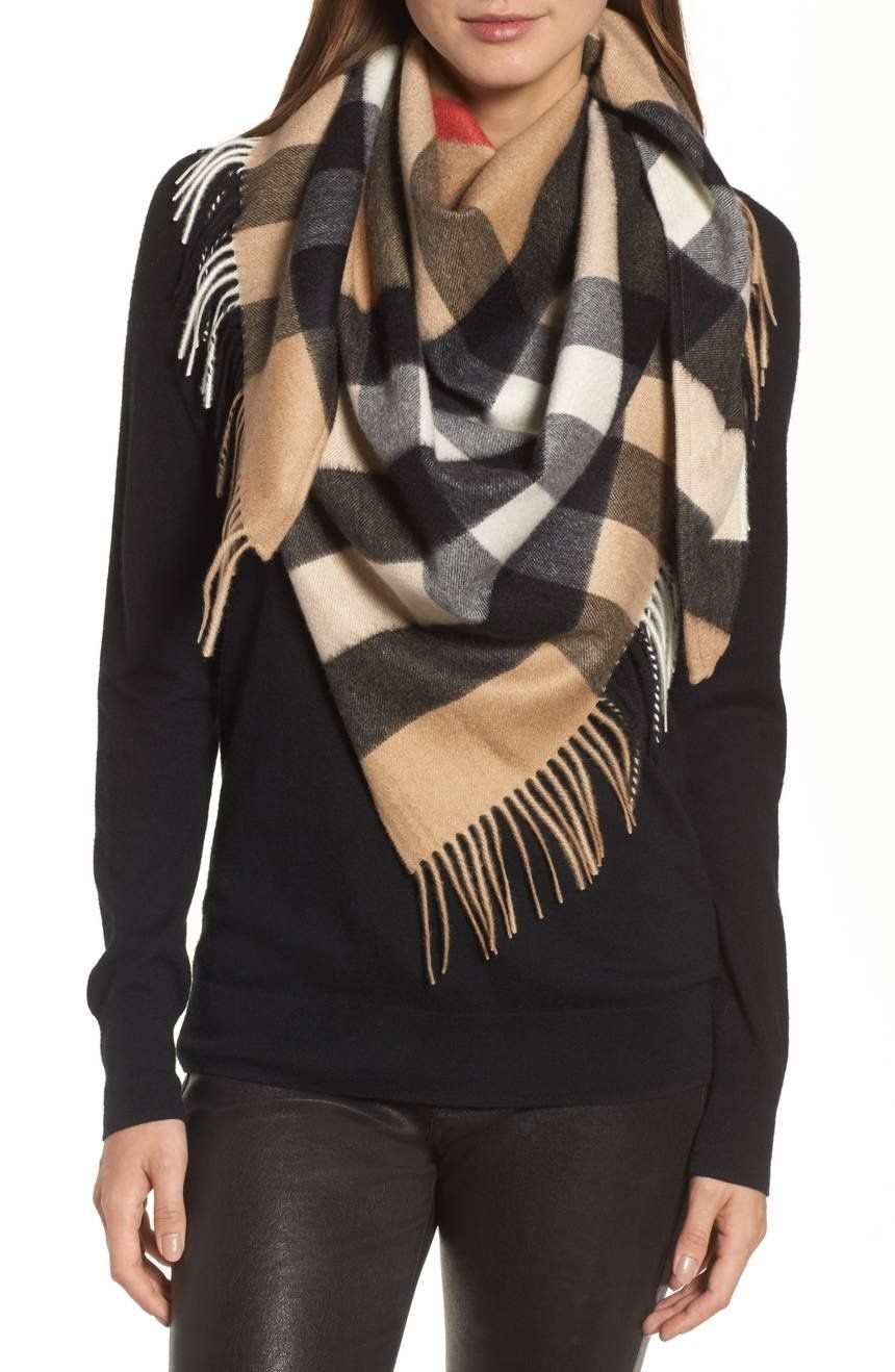 A fringe-trimmed triangle scarf is crafted in Scotland from cozy cashmere  and patterned in exploded-scale checks. f614fef4b26