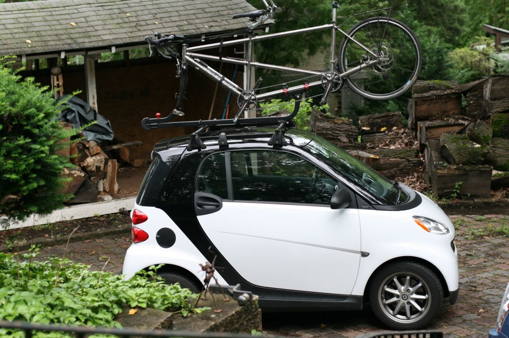 Smart Car With Tandem Bike And Roof Rack Loaded On Top I