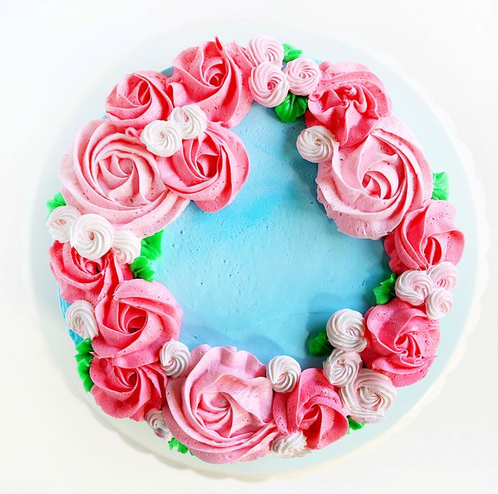 Simple pink rosettes adorn this light blue cake designed just for mom! Let me tell you about this cake. It was supposed to be really simple. Easy. No-fuss. Quick. Done. It was none of the above. Not because it is a complicated cake, but because nothing went according to plan. I had this idea in...