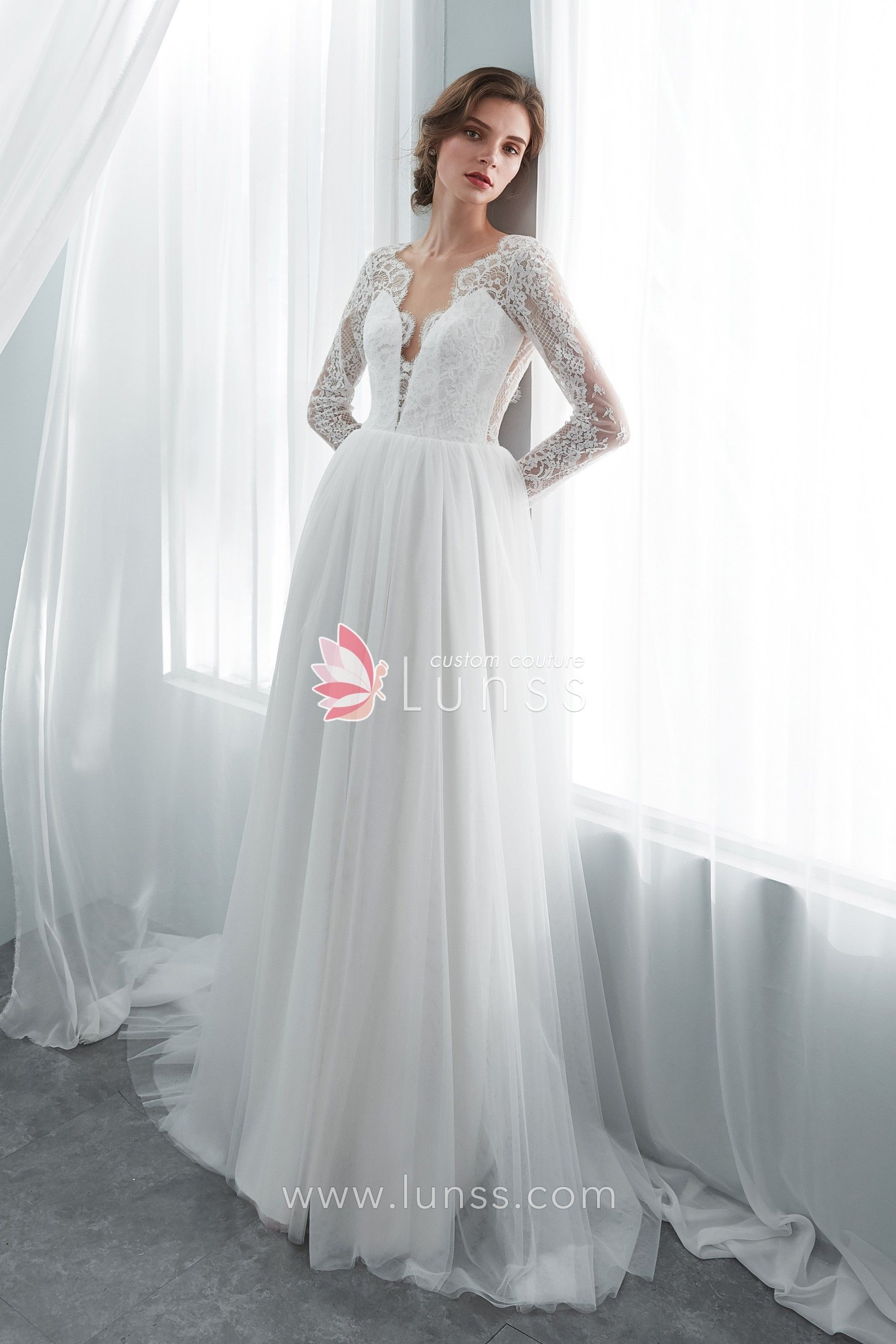 02b976a59b Lissome and romantic, this beautiful ivory long sleeve A-line wedding dress  features abstract lace bodice with scallop deep V neckline and sexy open  back, ...
