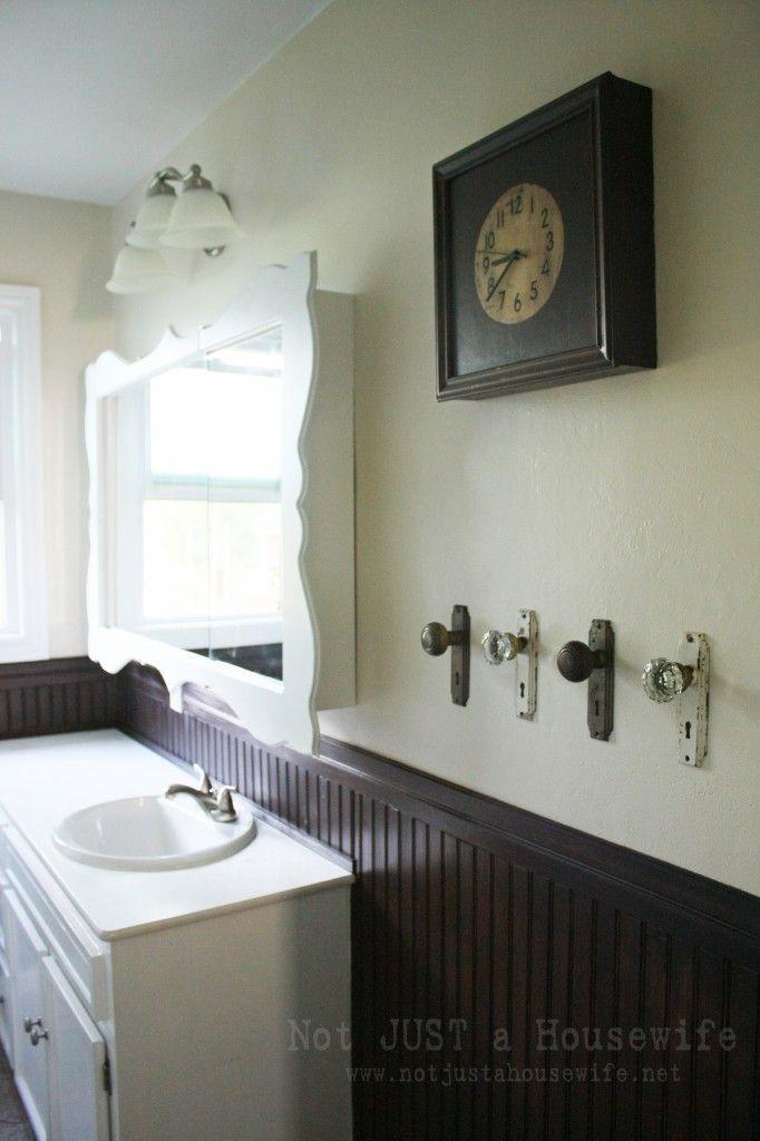 Old doorknobs as towel hangers.