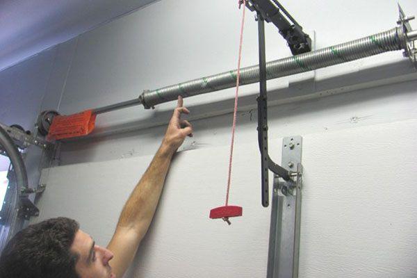 The Garage Door Spring Repair Garage Door Springs Adjustment
