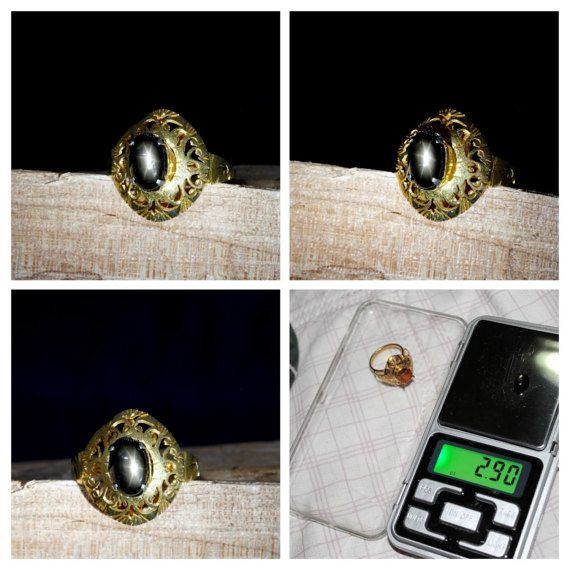 Natural Unheated Thai Golden Star Black Sapphire Cabochon Gemstone with Six Golden Ray Star set in Brass Holder Ring for Display 2.9 ct