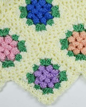 """Watch us review this beautiful Vintage Granny Popcorn Afghan Crochet Pattern! Design by: Maggie Weldon Skill Level: Intermediate Size: Afghan = 46"""" (115 cm) X 64"""" (160 cm), Each Motif = 5-1/2 """" (14 cm"""