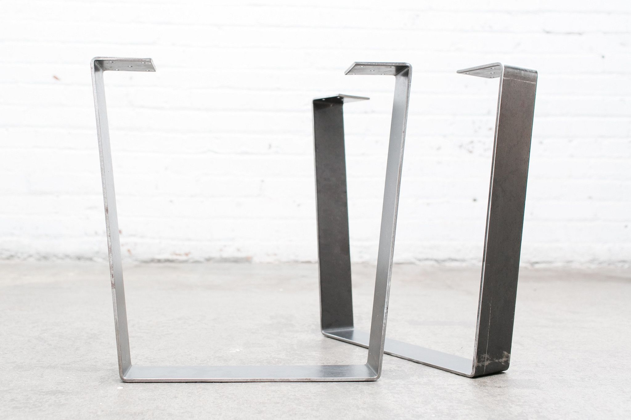 The Flat Steel Leg compliments industrial and modern