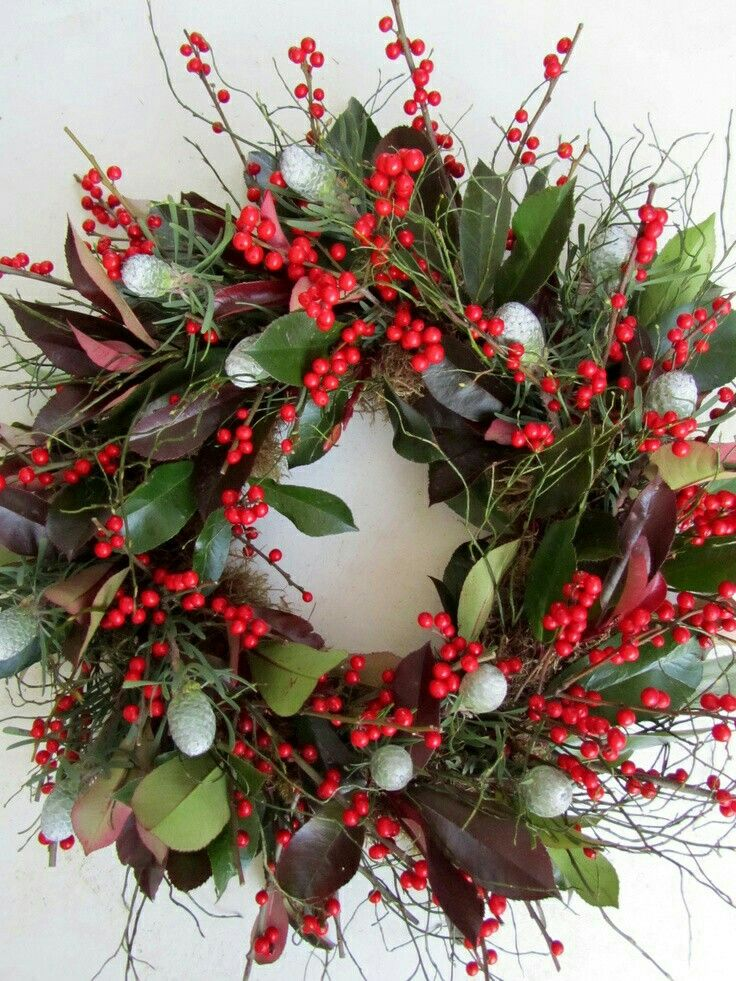 Photo of fall wreath with red berries and green leaves