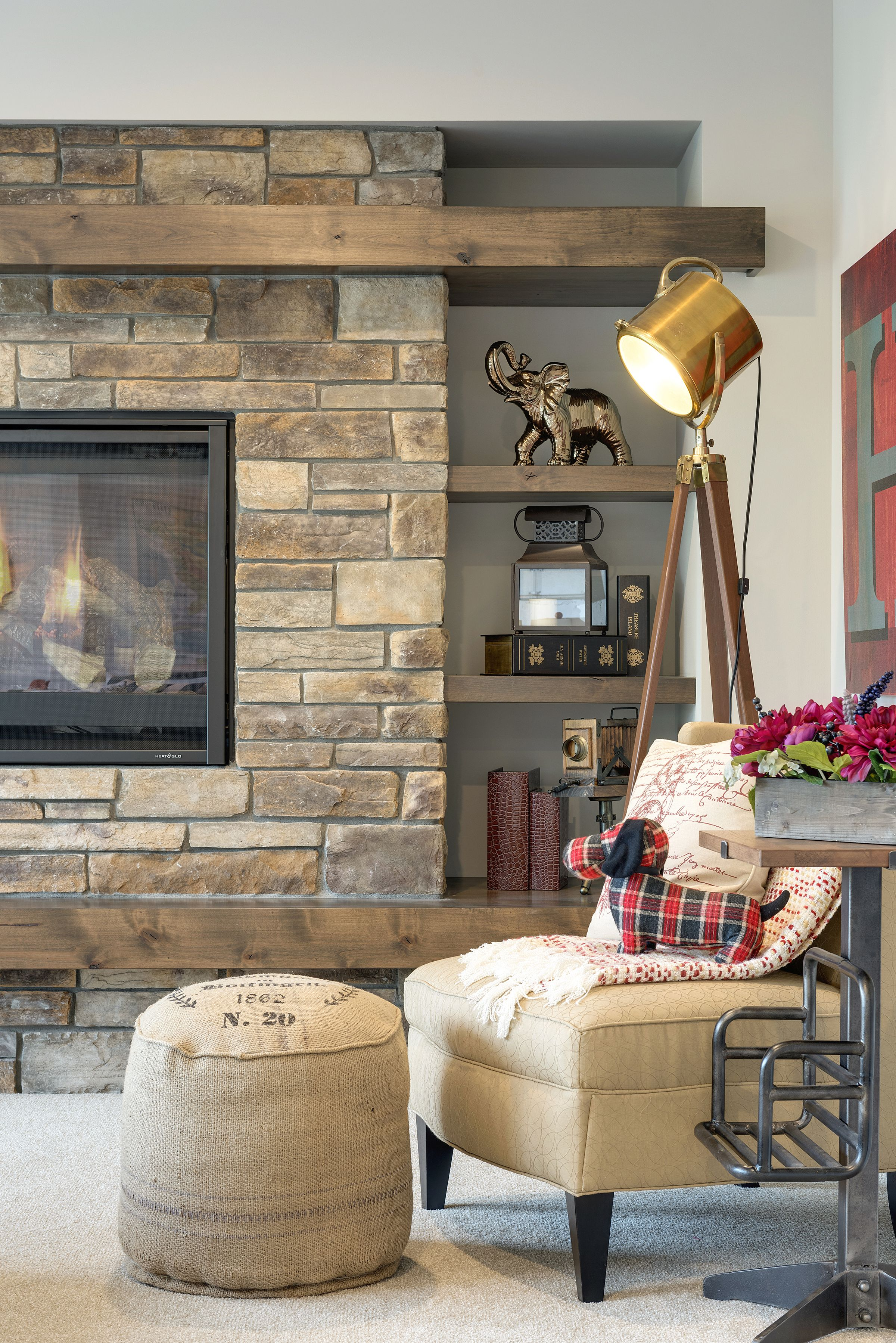 A Mid Wall Fireplace Heightens The Level Of Coziness In This