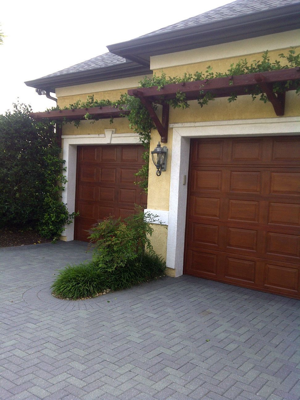 Mediterranean Garage With Babin Ironworks Custom Wrought: KApple Scapes Enhanced The Curb Appeal Of This Home With