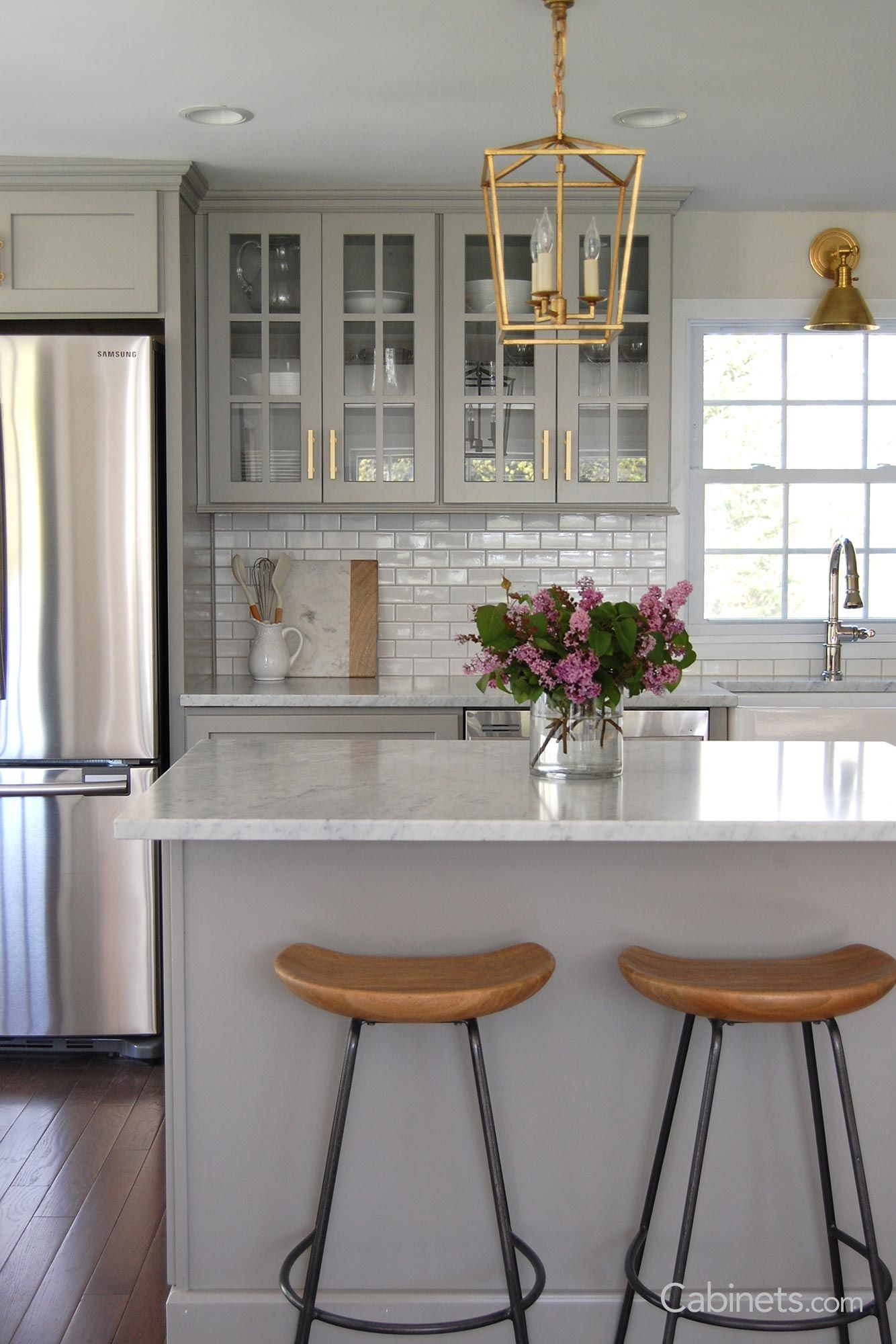 classic style light gray kitchen with muted gold hardware cabinets com light grey kitchens on kitchen remodel gold hardware id=99626
