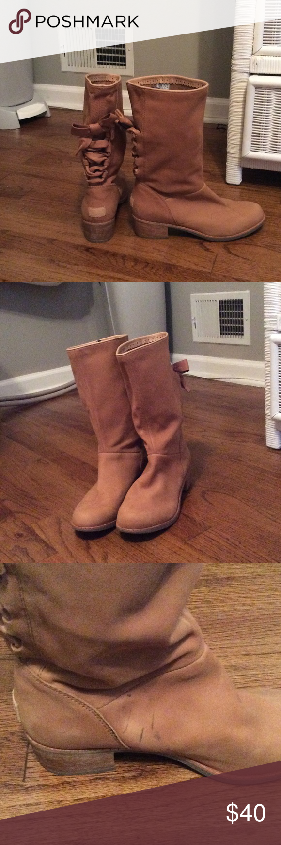 UGG tie boots Used pair of UGG boots. They tie in the back and are made out of leather and sheepskin. ***Please note the black markings on the inside of the boots. Pictures show this wear. Other than markings they're in great condition. UGG Shoes