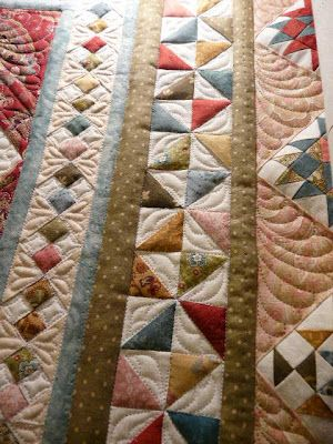 Beautiful idea for patchwork quilt borders - I love the four-patch-on-point idea, and the pinwheels. (Part of an Eye Candy Pattern, I think.)