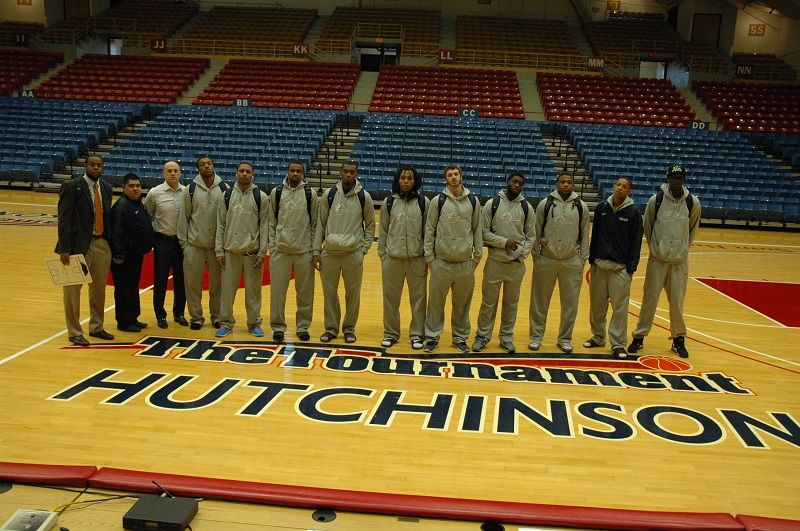 Team picture on the floor at the hutchinson arena