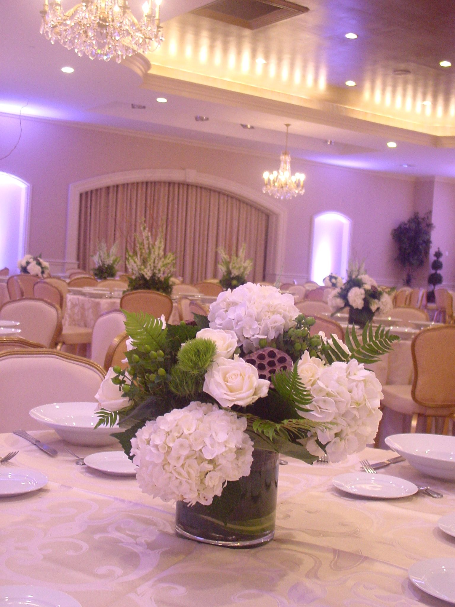 Green and white short wedding centerpiece of white hydrangeas, roses ...
