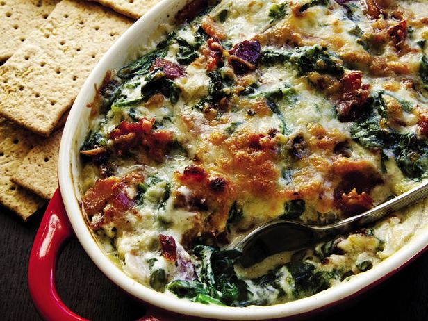 Spicy Bacon Spinach Artichoke Dip from CookingChannelTV.com.  I'm sure this would work in a crock-pot.  That's the plan anyway.