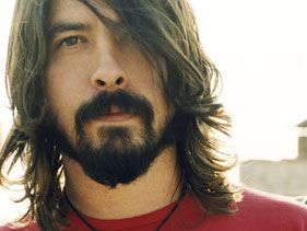 dave grohl... drums, sings, writes, plays guitar, cute, funny and bonus: played beelzeboss