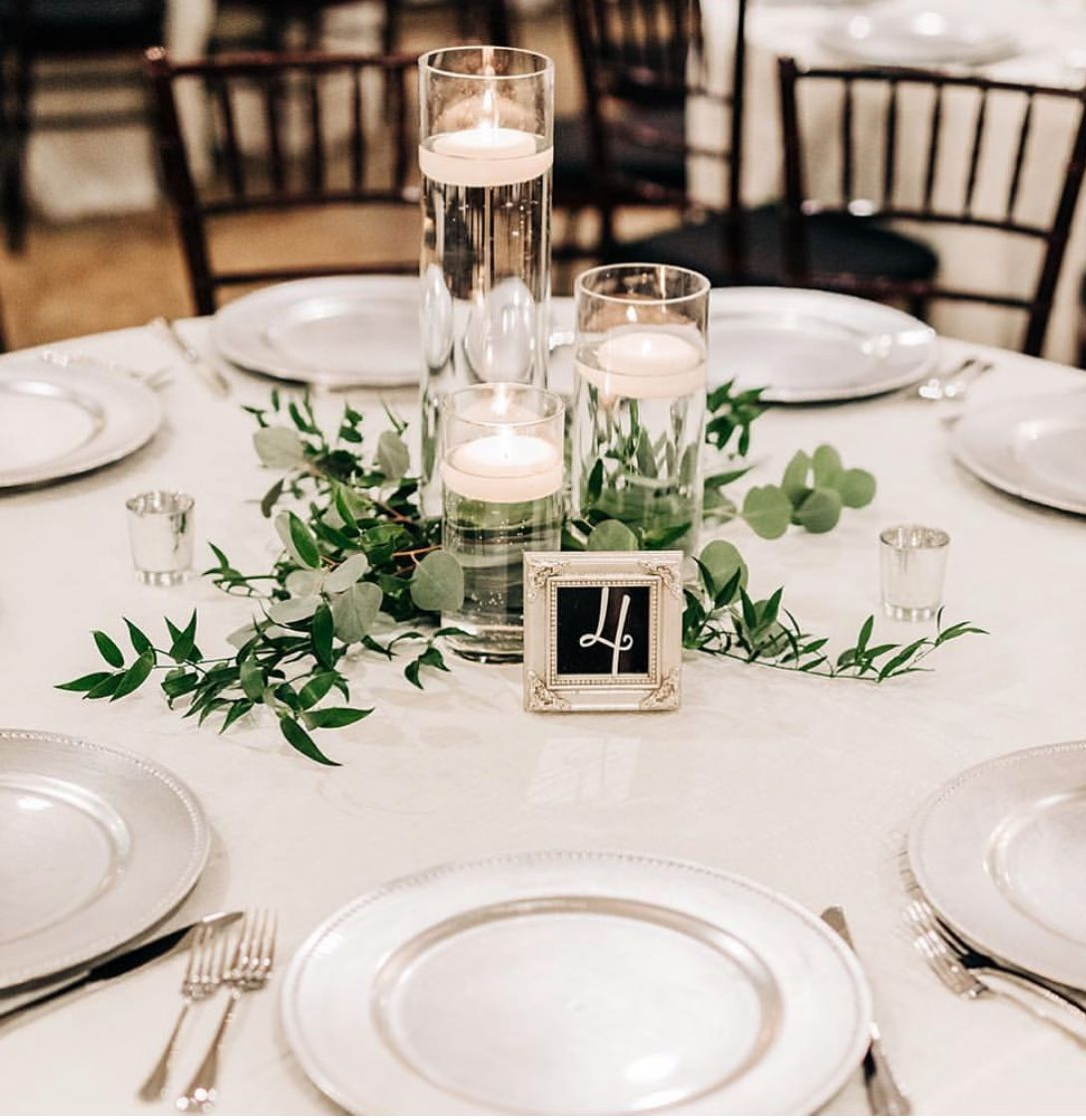 6 - 5 foot tables (seats 8) I love keeping the round tables simple like this. with either floating or regular candles and green foliage. #roundtabledecor
