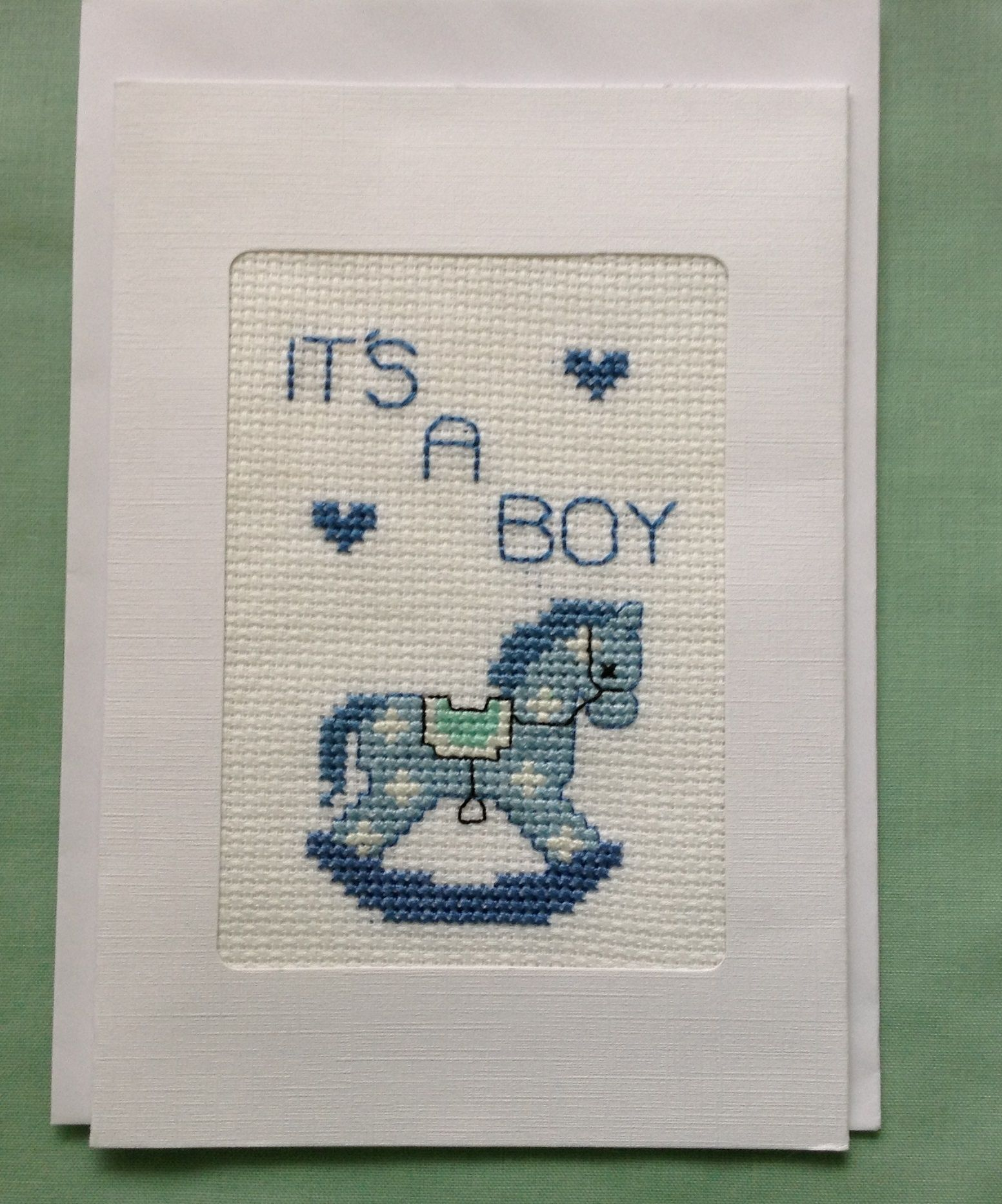 "New Baby Greeting Card – This lovely greeting card would be ideal for a new mother. Cross stitched on the front is a cute little Rocking Horse. It has an inner page; card message reads ""Congratulations on the arrival of your beautiful baby boy"". https://www.hand-made.com.au/LindabearsHandmade"