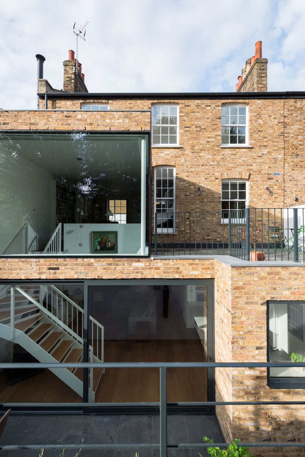 Reclaimed Brick House With Glass
