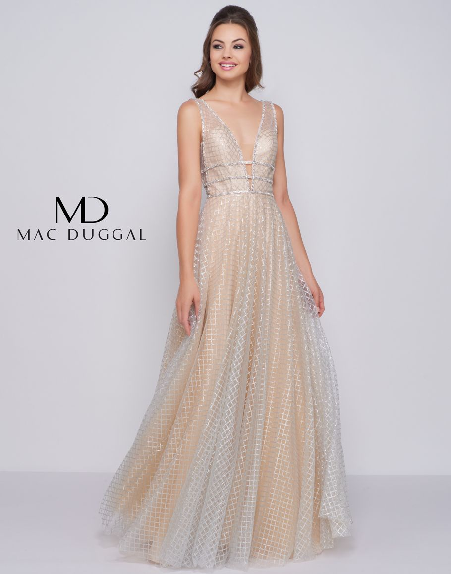 4d82d313daa V-neckline prom dress with sheer panel inset. The triple embellished bands  at the waist are sure to flatter your figure! The full skirt embellished  with ...