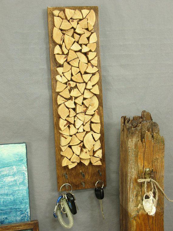 Stacked cedar wood key rack. Looks like chopped firewood. Modern ...