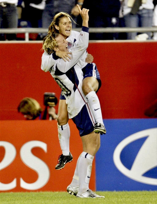 Mia Hamm (right) celebrates with forward Abby Wambach