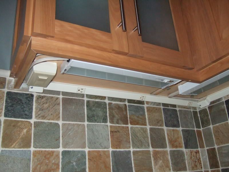 Genial Angled Plugmold To Hide Kitchen Outlets. Plugmolds Hide Under The Upper  Kitchen Cabinets. Is That Other Switch For The Garbage Disposal?