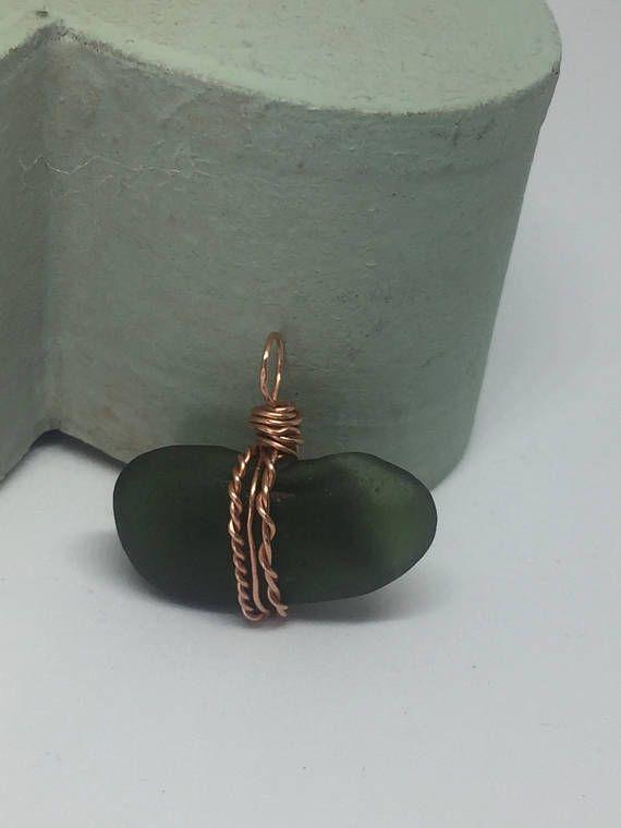 Green sea glass pendant wrapped in copper