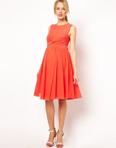 3b5e6b85dba We love the bold color and kicky shape of ASOS s knot-front dress ( 39).  Made from a breathable woven fabric