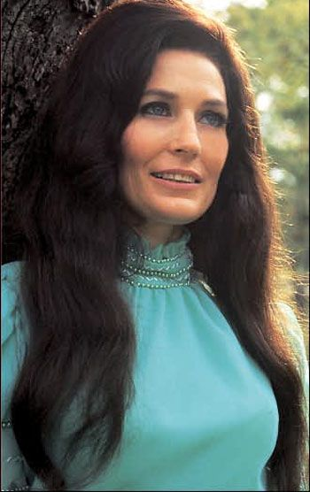 Loretta Lynn i love this womans voice. She reminds me about how pure the south makes you feel.. Its soothing.