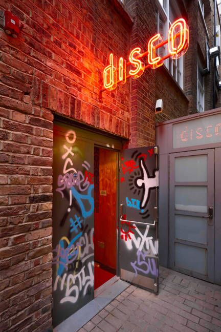 "Entry where they feel like they are entering a real underground night club. NEON DISCO sign. ""ALT UNDERGROUND"""