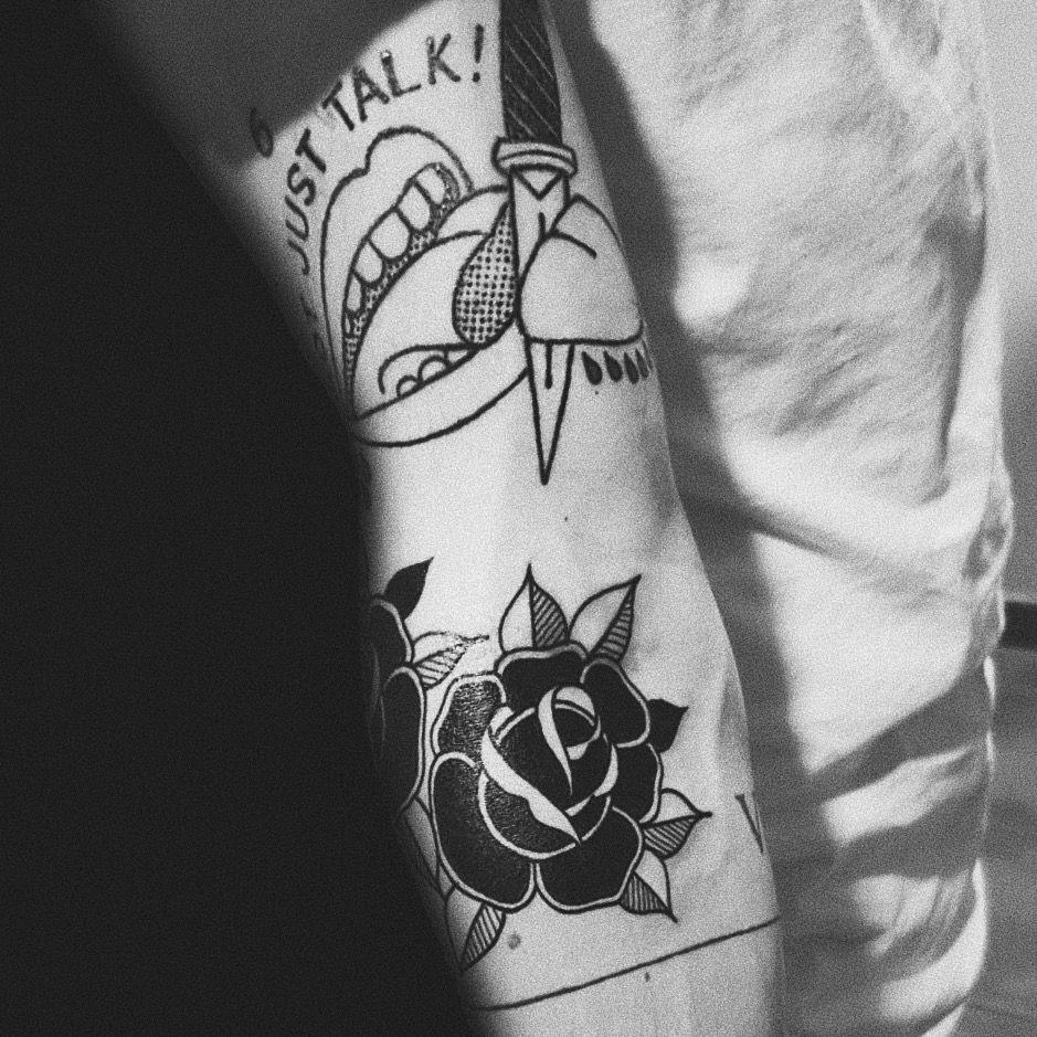 Traditional old school black rose not just talk tattoo mens arm