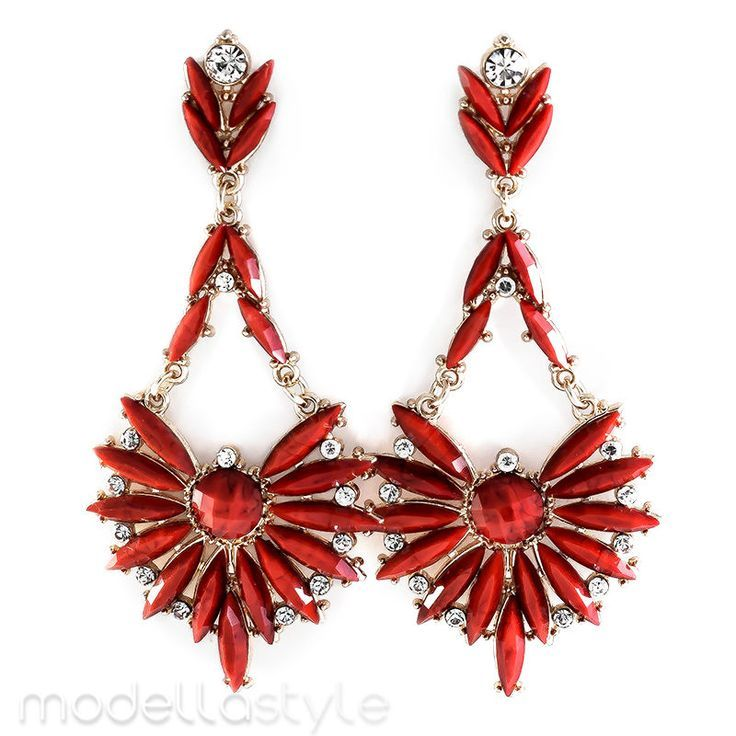 A pretty pair of flower, star-petal chandelier style earrings with sparkling rhinestones and colorful ruby red beads. Wear with heels and a fit-and-flare dress for a look that's perfectly chic. #ModellaJewelryBoutique