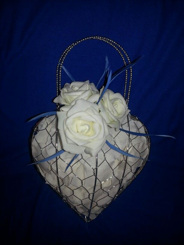Alternative to bridesmaid bouquet. For less than £4! Carmeal.com for heart bag,  ebay for foam roses, petals and feathers (fly fishing ebay store, cheaper than craft store)