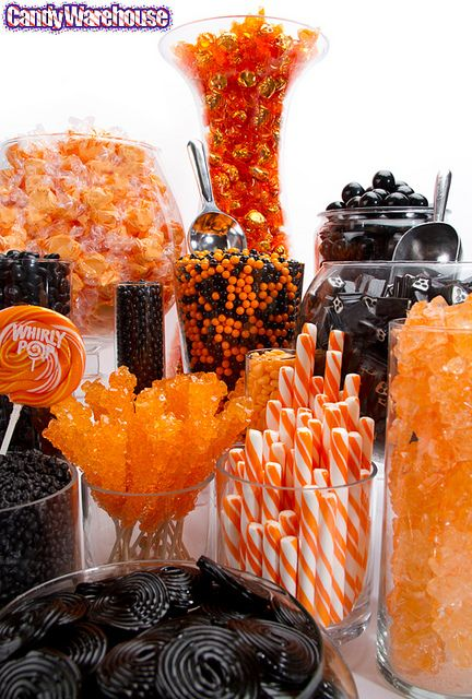 orange and black candy buffet by candywarehouse our school colors but the black licorice tastes so nasty would have to be there for looks lol