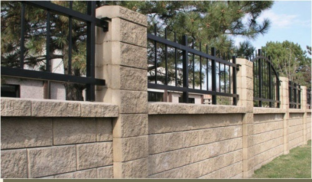 This Block Wall Fence Has Ornamental Iron Rails. | Dream House