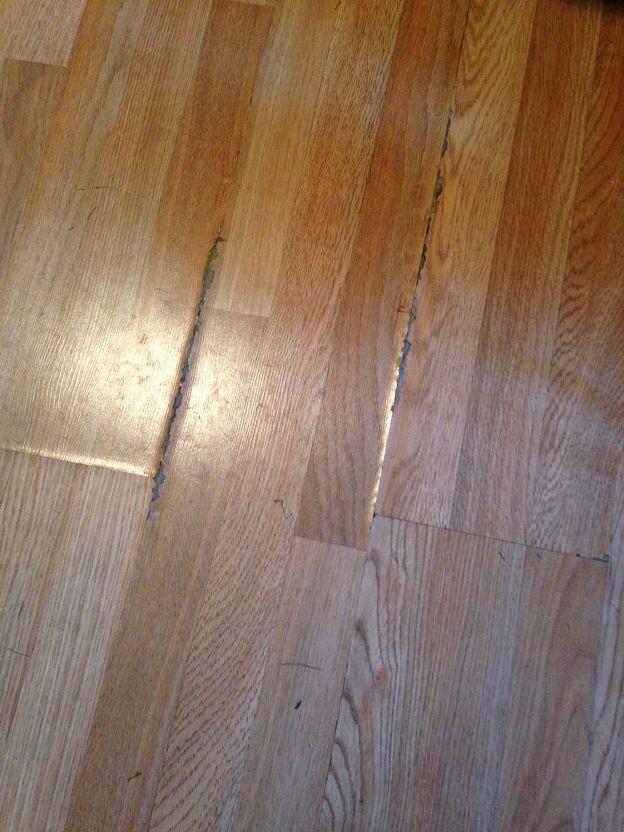 How do I camouflage water damaged laminate flooring