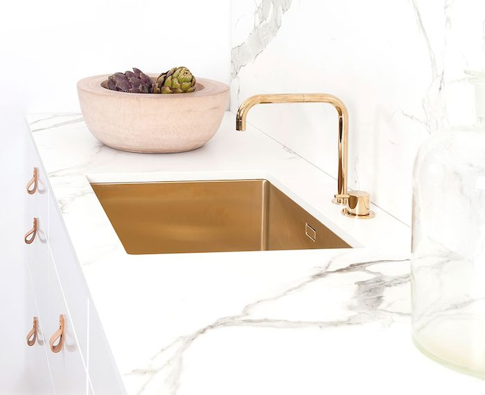a beautifully stylish look for a kitchen brass sink and tapwear white cabinets with leather tab pulls and a dekton in aura countertop and splash back - Brass Kitchen Sink