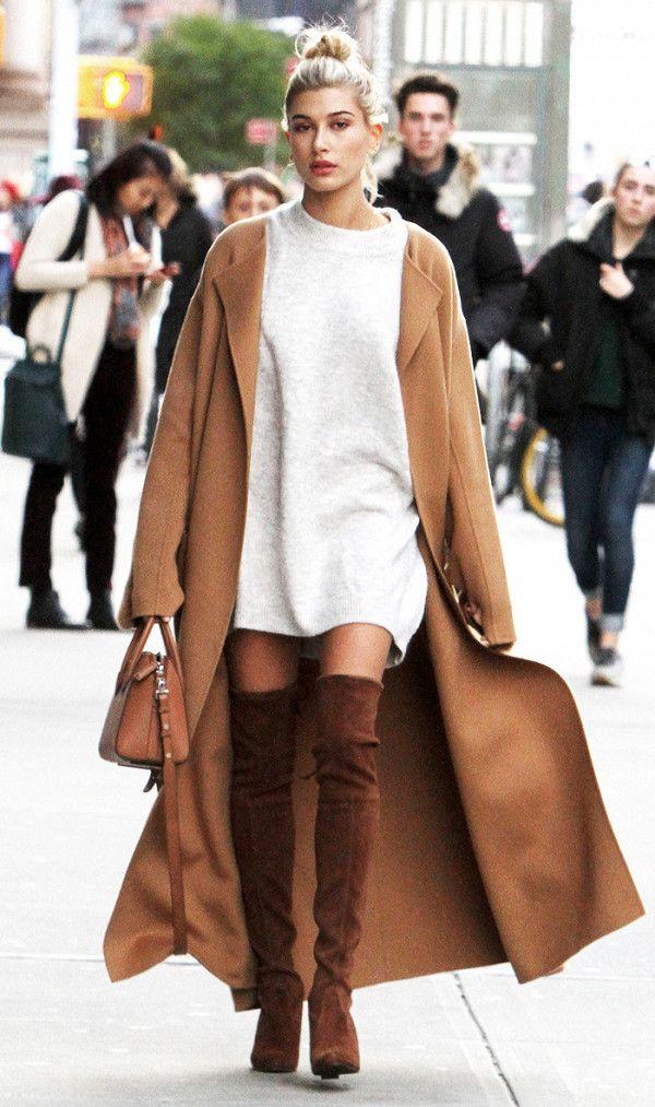 Hailey Baldwin in a long sweatshirt with thigh high boots