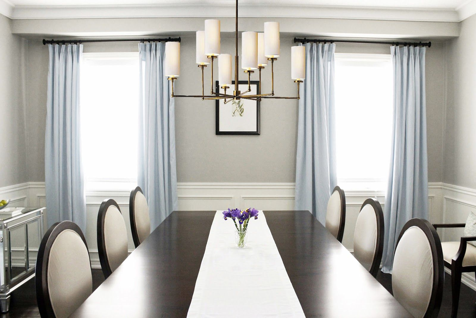 Dining Room In Benjamin Moore Revere Peter Paint Featuring Double Pedestal Mahogany Ding Table With Criss Cross Chairs Atop A Crystal Chandelier