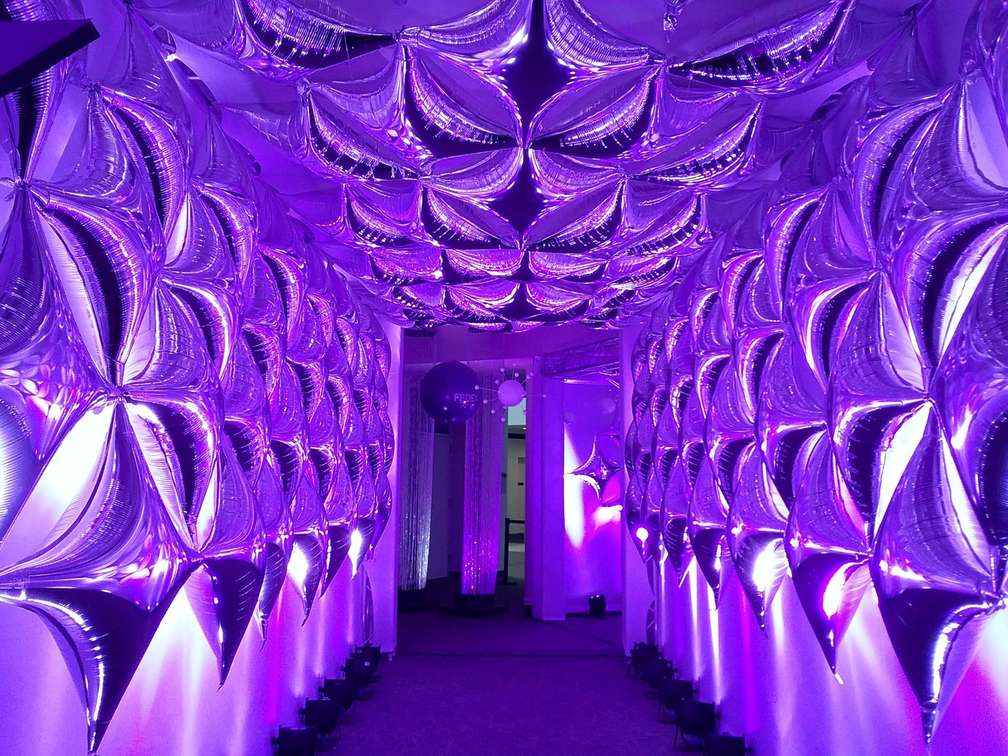 Glowing Purple Futuristic Modern Entryway For Corporate Event