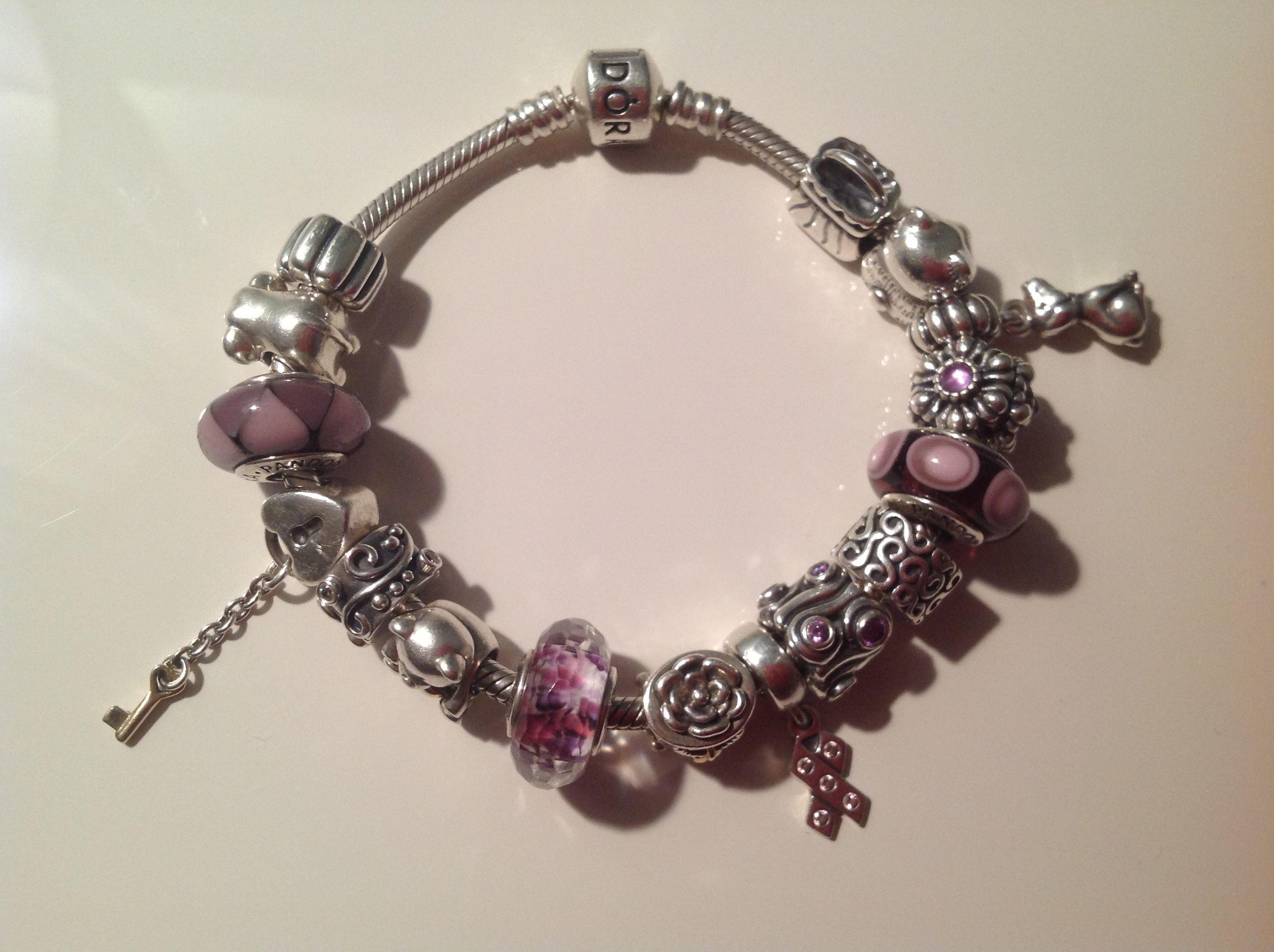 Stand Out Designs Jewelry : Purple and pink charms make this sterling silver bracelet