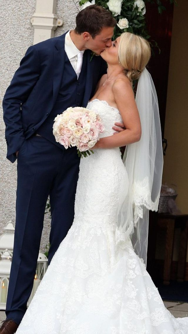Manchester United defender Jonny Evans marrying Helen McConnell 1st July 2013. Beautiful lace fishtail dress.