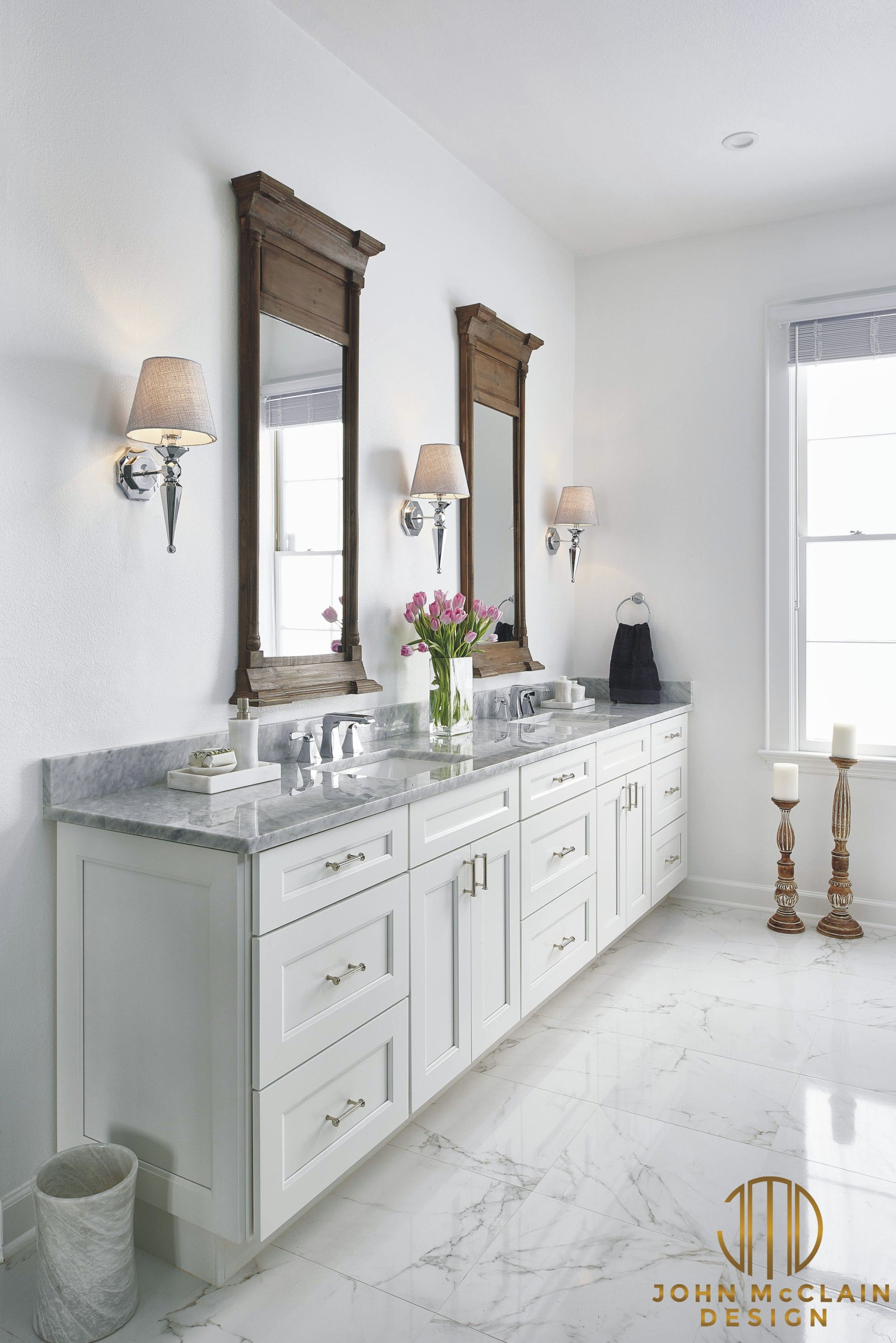 White shaker style cabinetry with carrara marble countertops ...