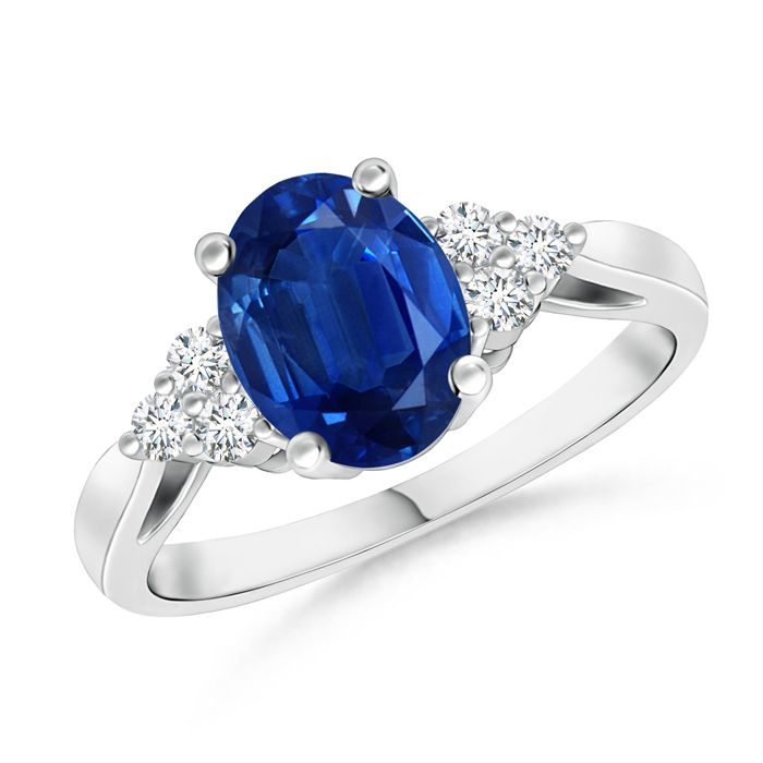 Oval Blue Sapphire Cocktail Ring With Trio Diamond Accents. Extravagant and elegant, this bold blue sapphire and diamond cocktail ring is a fantastic choice to seal the deal.