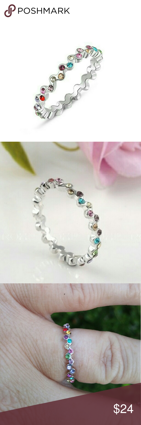 Platinum Plated Multi colored Crystal Band 6.5 & 8 Platinum Plated Multi colored Crystal Band Sizes 6.5 & 8 available. Jewelry Rings