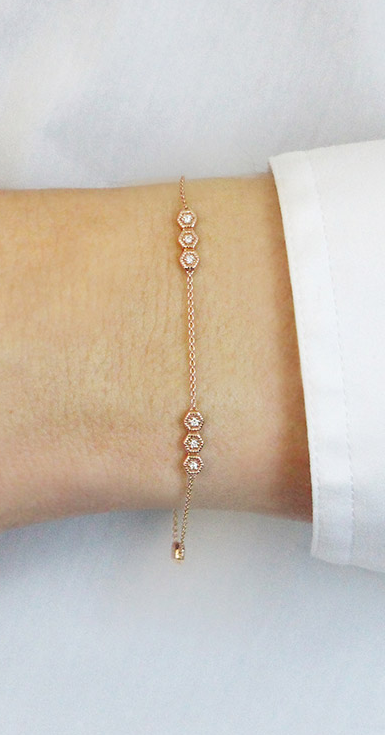 This Uniquely Sleek And Simple Rose Gold Station Bracelet Sparkles With Double Sided Hexagon Bars Diamonds Bracelets Danarebecca