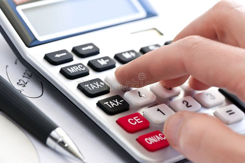 Tax Calculator And Pen Typing Numbers For Income Tax Return With