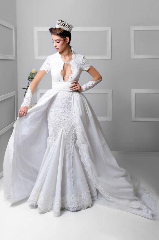 An off white royal wedding dress made form dentel and swarovski ...